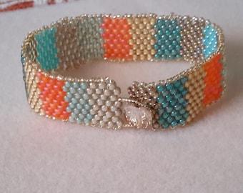 Peyote bracelet gold, turquoise, aqua, and coral