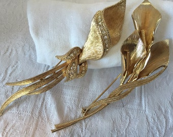Set of two Gold tone lily statement brooches