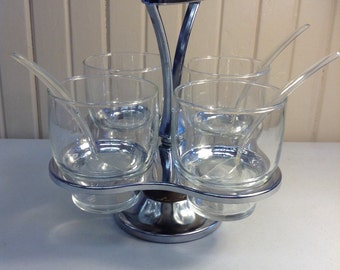 Five piece condiment set with silver tone caddy