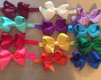 4  or 6 inch bows on elastic headbands