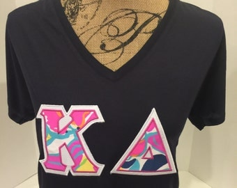 BELLA loose and flowy Greek Letter shirt with Lilly Pulitzer fabric letters - any Greek letters - stitched on Bella Flowy v-neck t-shirt.