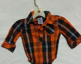 3 - 6 months. The most adorable little baby girl orange plaid vintage body shirt with one small front pocket, by.