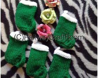 Green mini knitted christmas tree stockings