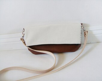 Small canvas fold over crossbody bag with zipper and vegetable tanned leather straps
