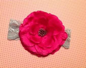 Hot pink flower on a grey lace headband