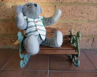 Dark Grey Felt Teddy Bear sitting on his school bench.