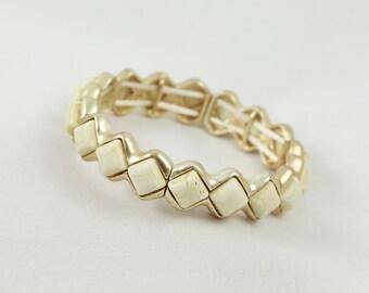 Small diamond shape ivory and gold stretch bracelet