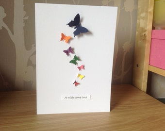Adoption celebration card. Rainbow of butterflies