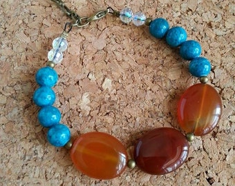 Beautiful bracelet of stone/metal/glass/Turquoise/brown orange/strap stackable/Gemstones/charm pen/Stacking bracelet/Feather charm