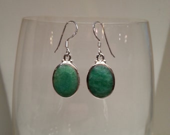 Green emerald and sterling silver earrings.