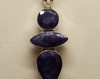 Faceted blue sapphire and sterling silver pendant and chain