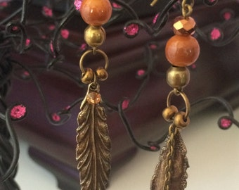 Long metal feather earrings with beads