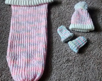Loom knit baby cocoon, loom knit baby hat, and loom knit baby hand mittens.