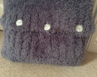 Fluffy hand knitted cushion