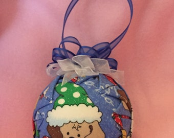 Quilted ornament .  Christmas.dog