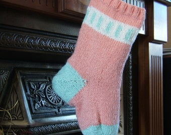 Salmon pink Christmas Stocking with mint green heel and toe.
