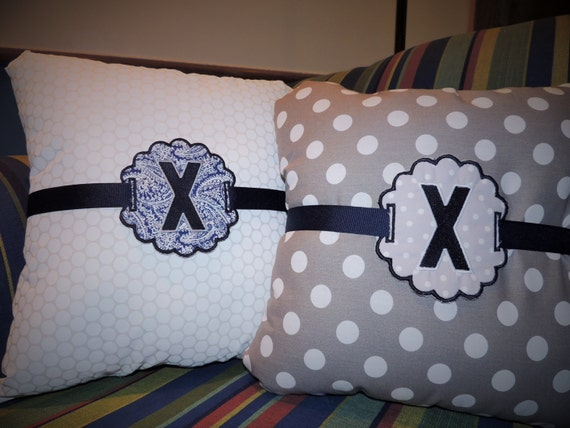 Xavier University pillow and pillow charm
