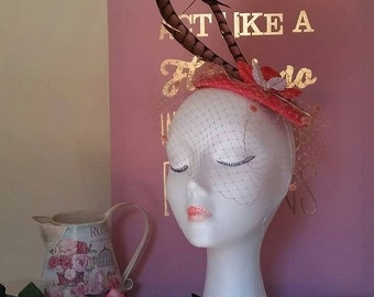 Artisan headdress with base color coral fabric lined