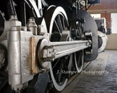 Cool steam locomotive drive rod photos.  Professional print in multiple sizes.  Very neat image, great for home, office, business, of gift.