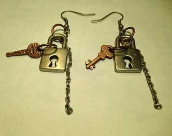 Steampunk earrings with lock, key, and chain.