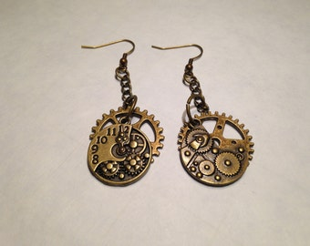 "Steampunk copperd colored earrings with large gear and collection of gears in one piece. Approximatley 2"" long."