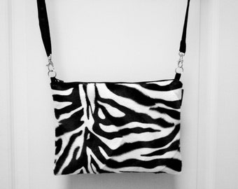 Satchel flat imitaion zebra fur and shoulder strap.