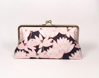 Lotus in black clutch purse