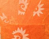 17 sheets orange spiral paper