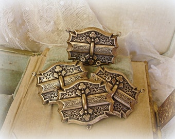 set of 4 vintage reproduction centerpieces . large size 3 rings necklace connectors . rosary centers
