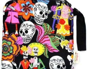 Small 9 x 9 Wet bag / Snack / Swim / Diapers / Los Novios Calaveras Skull Fabric / SEALED SEAMS and Snap Strap
