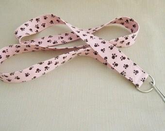 Black paw prints on pink - handmade fabric lanyard