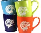 4 Hedgehog Mugs - Sky Blue, Navy Blue, Green & Orange microwave-safe coffee cups