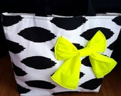 Black and white Ikat tote bag with bright yellow green bow