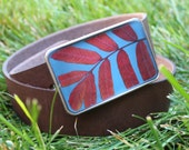 stem of an autumn sumac belt buckle in sky blue