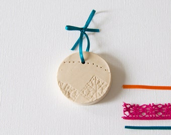 wall decor in ceramic - lace imprint medallion - handmade sculpture