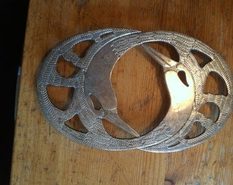 Bird heads going roung and round 1980s  trivet table or wall 10  inches by 6 inches silverplate made in Italy