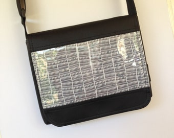 Large size grey pyramid fabric cross body satchel style bag.