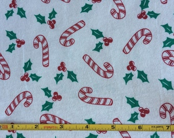 Candy canes on 100% cotton  jersey knit fabric  1 yard