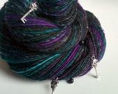 Handspun Halloween Art Yarn - ENIGMA - Grey, Black, Purple, Pine Green. Skull Key Charms, Beads. Fantasy, Dark, Secret.  229 yds, 4.2 oz