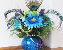 Victorian Wild Child Peacock Silk Floral Centerpiece Arrangement in green, blue, turquoise with real peacock feathers, butterfly & fringe