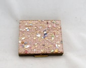 Vintage 1950s pink and gold glitter compact