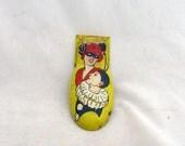Vintage 1960s masquerade tin clicker toy