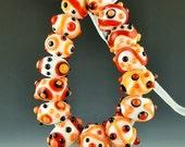 a set of 15 handmade lampwork glass beads combining orange red black and white - Orange Tropic