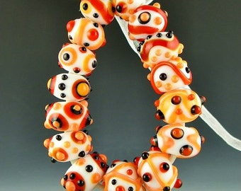 a set of 15 handmade lampwork glass beads combining orange red black and white - Orange Tropic