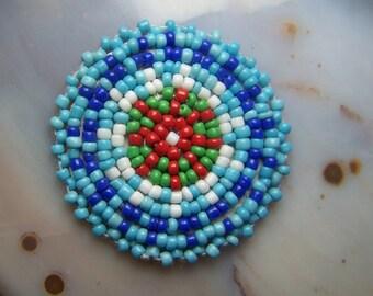 Seed bead rosette circle for Native American Indian regalia  - beadwork 1.5 inch glass beads on leather back blue red mandala medicine wheel