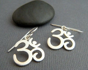 small sterling silver Om earrings. Ohm earrings. dainty dangle. petite drop earrings. simple zen yogi yoga jewelry. gift for her