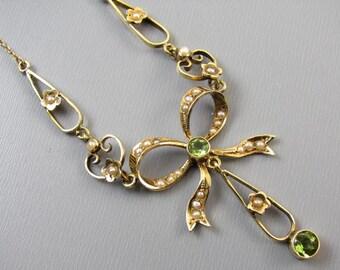 Antique Edwardian 14k gold green peridot seed pearl ribbon bow festoon lavaliere pendant necklace
