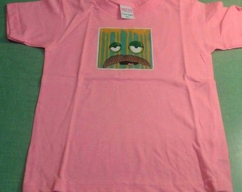 Pink size 4 kids shirt with mustache monster!