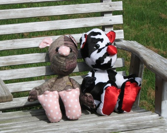 Cowhand Bear made from plush holstein fur while French bear is an artist bear