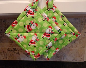 Christmas Santa's on Lime Green Background Quilted Potholders or Hotpads Set